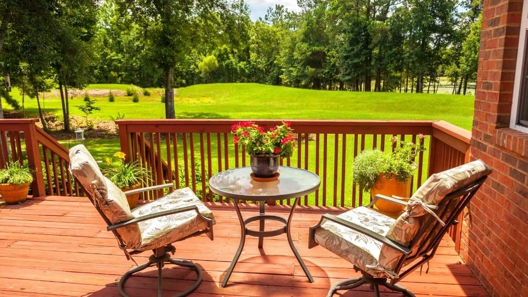 A nice deck with a view of backyard.